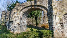 Old stone bridge with two arches, a dirt road in the Proosdij park royalty free stock photography