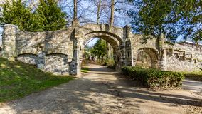 Old stone bridge with two arches, a dirt road in the Proosdij park royalty free stock images