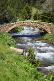 Old stone bridge. Vall de Ransol (Andorra). Old stone bridge over a mountain stream in Vall de Ransol (Pyrenees, Andorra Royalty Free Stock Photo