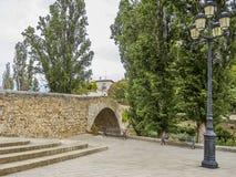 Ancient stone bridge. Old stone bridge in the village of Aranda de Duero Stock Photos