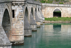Old stone bridge in Visegrad. Close-up image of old stone middle age bridge pillars, Visegrad, Serbia royalty free stock photography