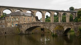 Old stone bridges in Dinan on a cloudy day in summer royalty free stock image