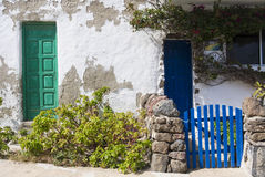 Old stone build house with green and blue doors and gate. Stock Images