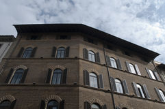Old stone buildig and fancy windows firenze city Royalty Free Stock Photo