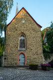 Old Stone Building. Behind Church With Cobblestone Walk Stock Image