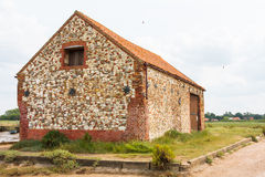 Old stone barn building norfolk england Royalty Free Stock Image