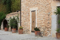 Old stone building with potted plants Stock Image