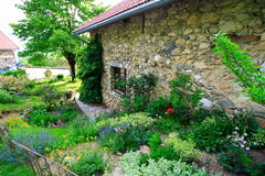 Old stone-built house. Superb garden and stone-built house in the the french countryside near grenoble Royalty Free Stock Image
