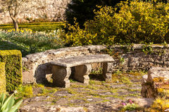 Old stone carved bench in garden Stock Image