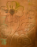 Old stone carving flower decadent background. On fence wall Royalty Free Stock Photo