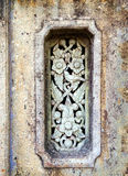 Old stone carving wall. Classical Thai decorative vintage ornament on stone wall Royalty Free Stock Photos