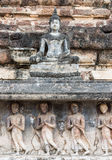 Old stone carvings of the Buddha image and monks Stock Image