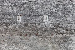 Old stone castle wall texture, cannon windows Stock Images