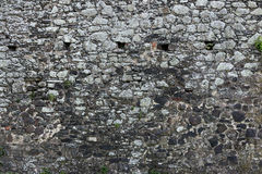 Old stone castle wall texture. With cannon windows royalty free stock photos