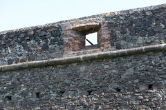 Old stone castle wall texture. With cannon windows royalty free stock image