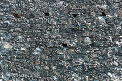 Old stone castle wall texture. With cannon windows stock photo