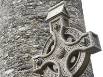 Old stone celtic cross in a traditional irish graveyard Royalty Free Stock Image
