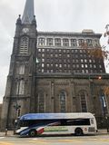 Downtown Cleveland church. Old stone church and a city bus on a dreary day royalty free stock photo