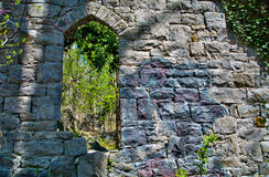 Old stone church ruins in Patapsco State Park in Maryland. The remnants of an ivy covered old stone wall and window are all that remain of this 19th century royalty free stock images