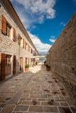 Old stone citadel on sea coast at city of Budva, Montenegro Stock Photos