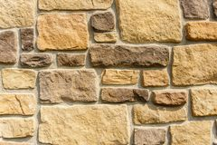 Old stone cladding plates on the wall closeup. Royalty Free Stock Image