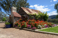 Old Stone Cottage. With flowering garden Royalty Free Stock Photography