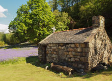Old Stone Cottage Outhouse in field Stock Photo