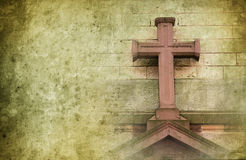 Old stone cross. On the wall in retro design with copyspace for text Royalty Free Stock Photography