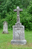 Old stone cross. An old stone cross in the cemetery Royalty Free Stock Images