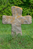 Old stone cross in grass Royalty Free Stock Photos