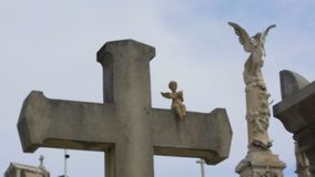 Old stone cross with little angel sculpture at Chateau Cemetery in Nice, France. Stock footage stock footage