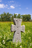 Old stone cross on meadow Royalty Free Stock Photography