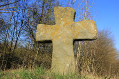 Old stone cross on meadow Royalty Free Stock Images
