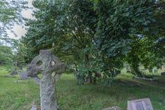 Old stone cross. In a church graveyard Stock Photos