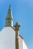 Old stone cross and roof Stock Images