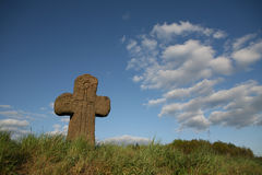Old stone cross with sword symbol Stock Photos