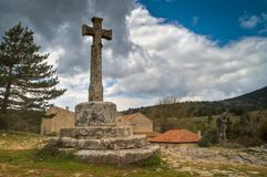 Old stone cross in town Royalty Free Stock Image
