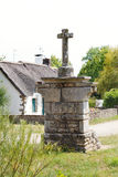 Old stone cross in village de Breca, France Royalty Free Stock Photo