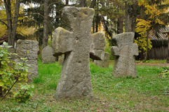 Old stone crosses on a cemetery Stock Photos
