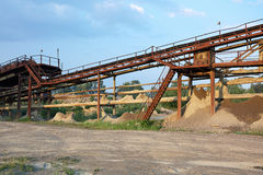 Old stone crushing plant. Gravel mill Stock Images