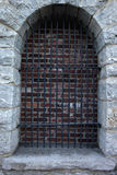 Old stone entrance with steel bars Stock Photo