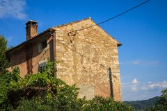 Old stone facade of the house Stock Photo