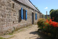 Old stone farm with blue shutters Stock Images