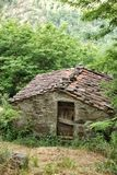 Old stone farm building with tiled roof. Near the tiny rural village of Benabbio, Italy Stock Image