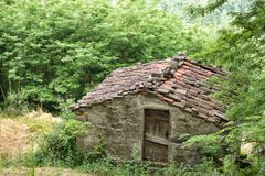 Old stone farm building with tiled roof. Near the tiny rural village of Benabbio, Italy Royalty Free Stock Image