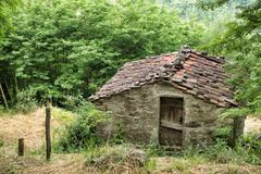 Old stone farm building with tiled roof. Near the tiny rural village of Benabbio, Italy Stock Photos