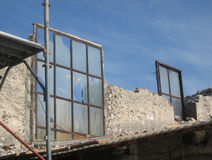 Old Stone Farmhouse With Scaffolding. Window detail from an old Italian stone farmhouse in the process of being demolished Royalty Free Stock Photos