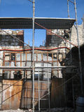 Old Stone Farmhouse With Scaffolding 1. An old Italian stone farmhouse in the process of being demolished Stock Photo
