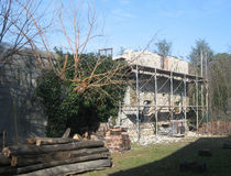 Old Stone Farmhouse With Scaffolding. An old Italian stone farmhouse in the process of being demolished. An adjoining breezeblock building can be seen on the Royalty Free Stock Images