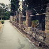 Old stone fence walking path royalty free stock photos